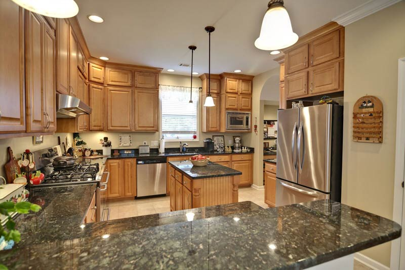 Delightful Granite Countertops Green Maple Cabinets US Affordable Granite Company,